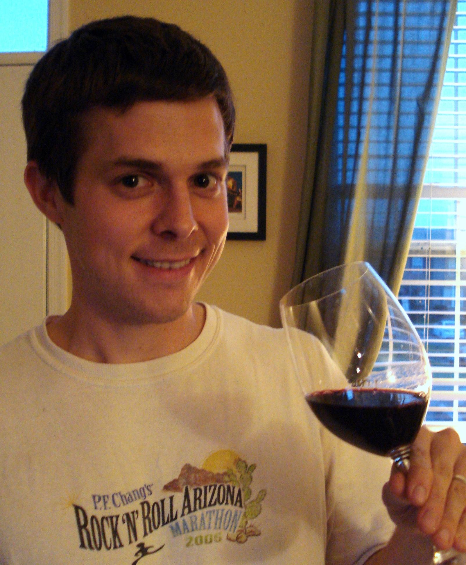 Matt drinking red wine from wine glass