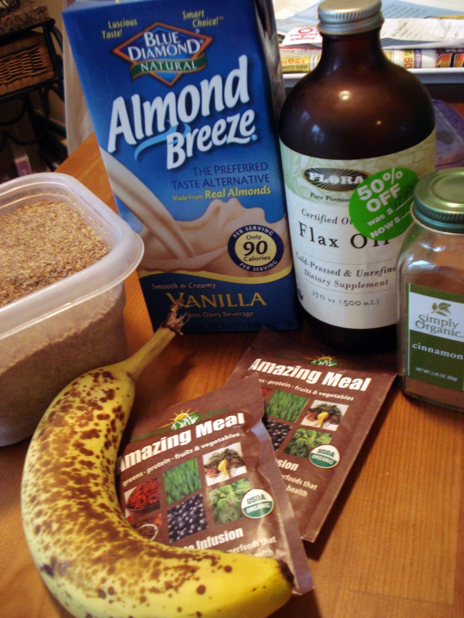 "Ingredients for ""Amazing Meal"" Chocolate Smoothie; banana, flax oil, almond milk, amazing meal packet"