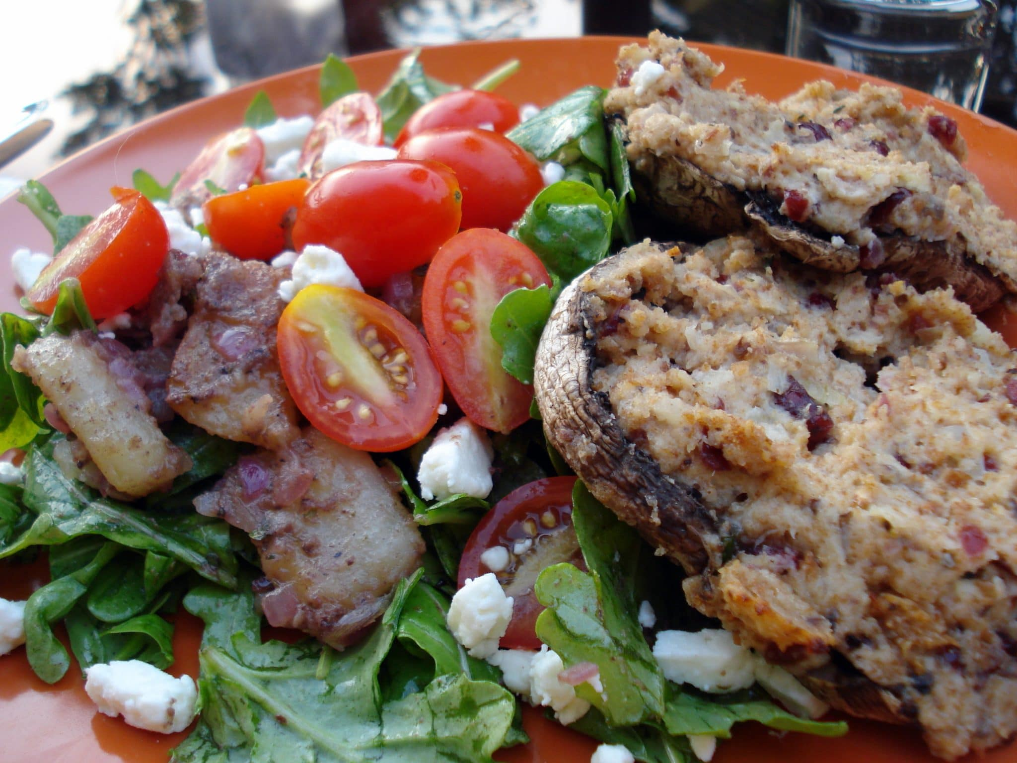 Close up of Goat Cheese and Rosemary Stuffed Portobello Mushrooms with side salad