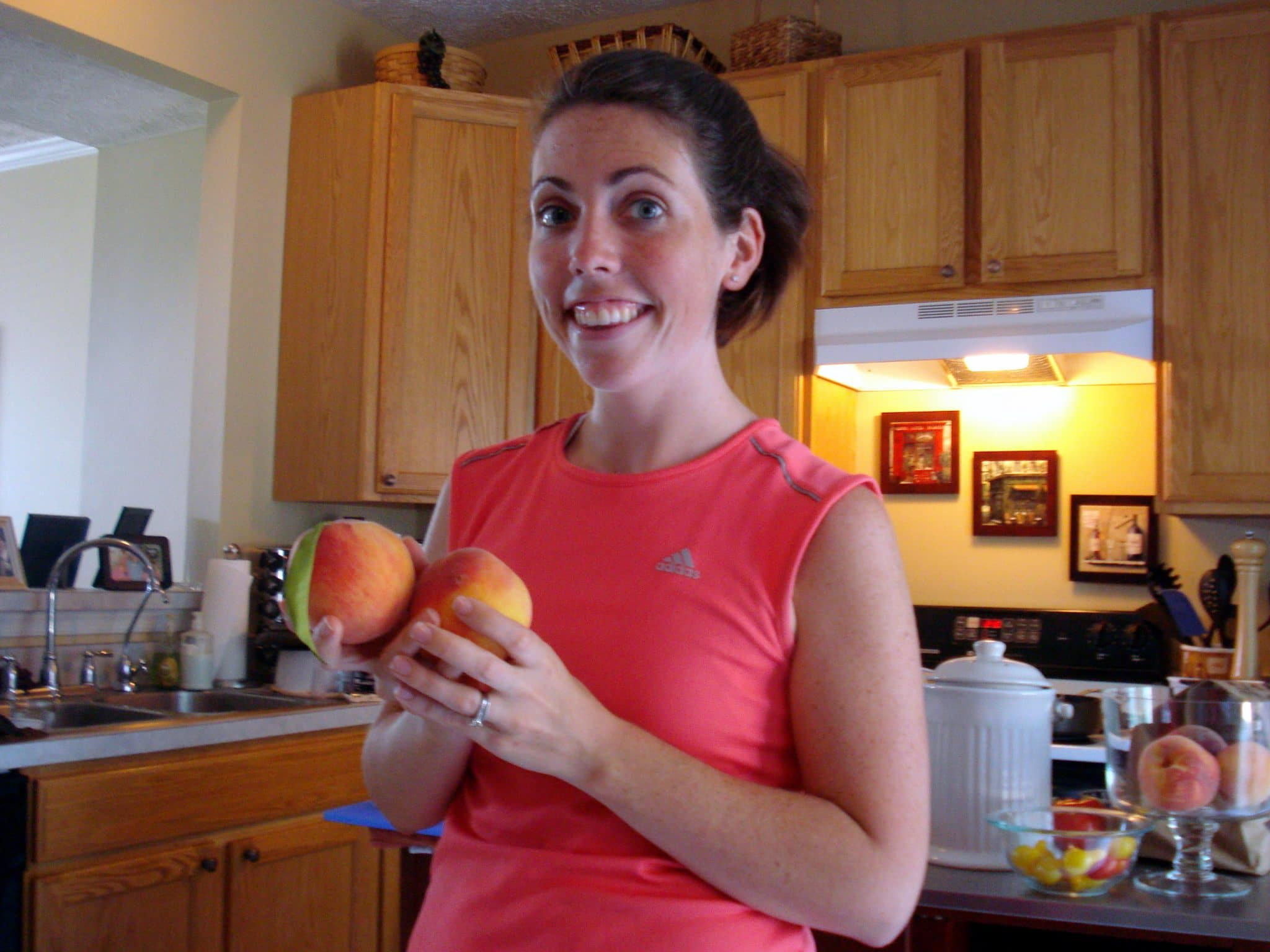 Woman holding fresh peaches