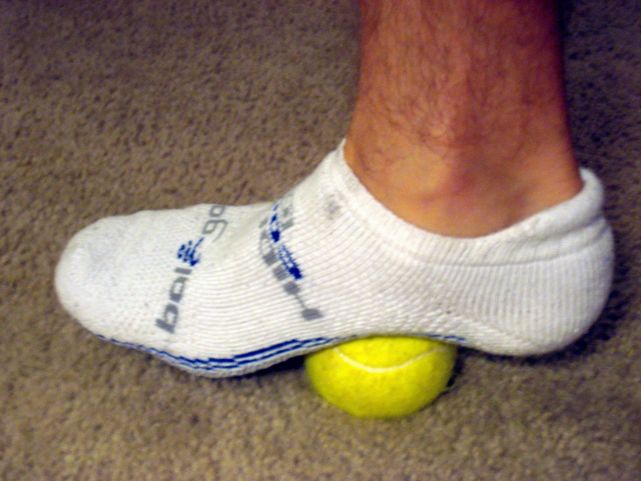 Tennis ball of roll out arch of foot