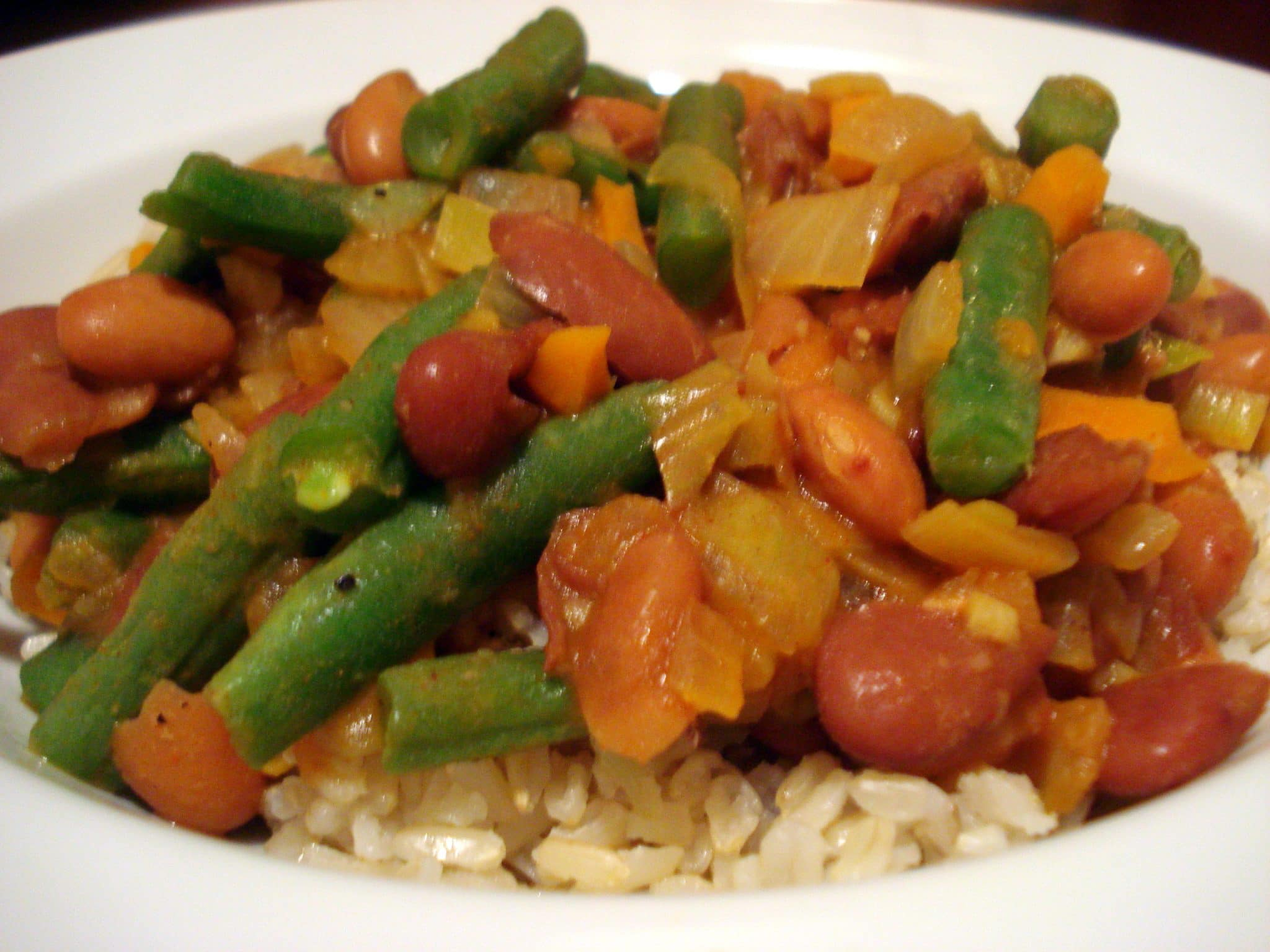 Bean stew with green beans and onions over rice