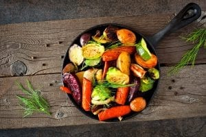 Cast iron skillet of colorful roasted vegetables