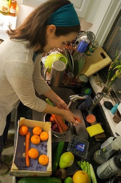 Woman prepping produce to be juiced