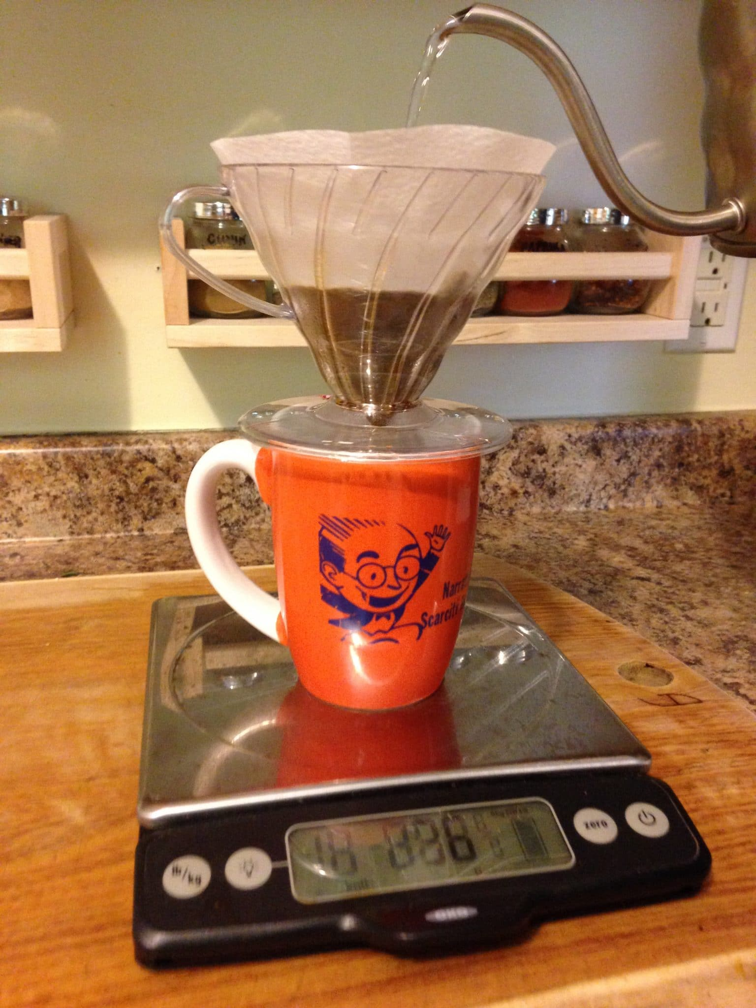 Making a pour over of coffee at home, on a scale, in the kitchen